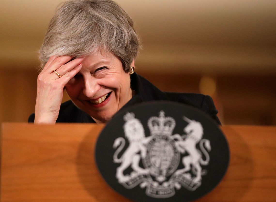 May laughs of her mistake during her press conference last Thursday