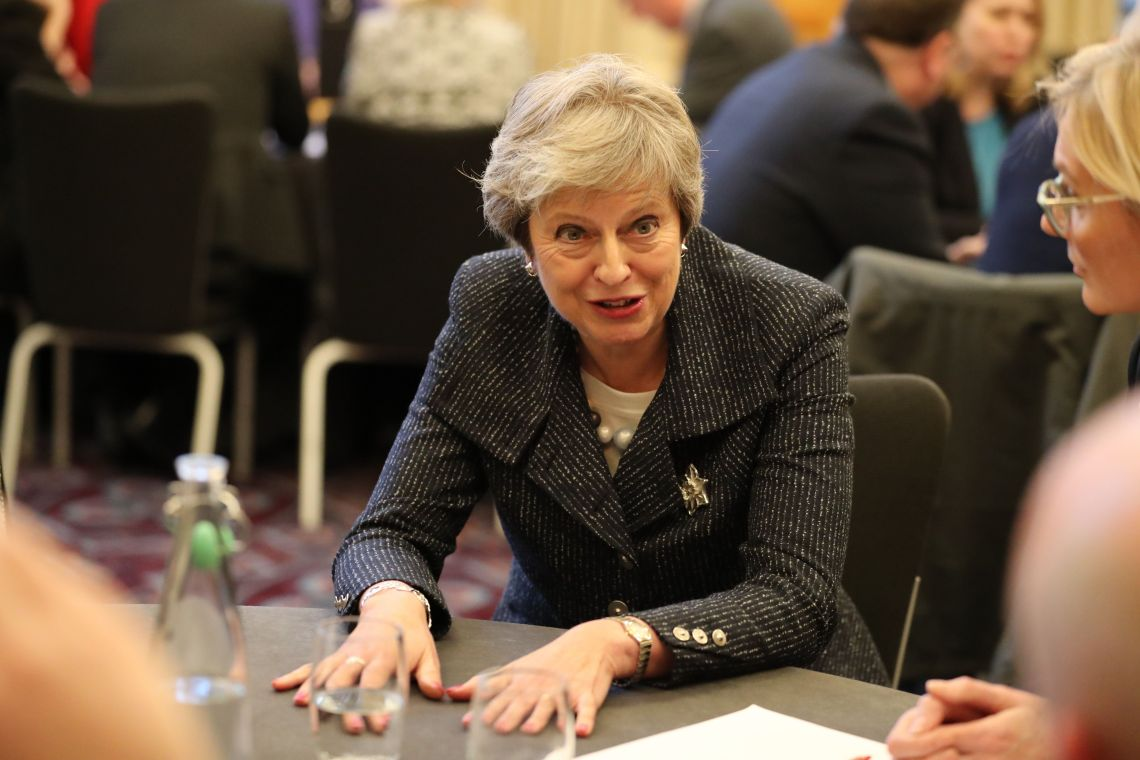 Theresa May pushes her plan on a trip to Belfast
