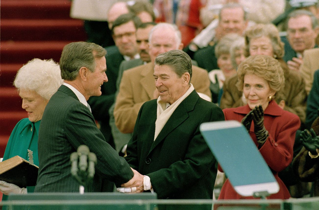Ronald Reagan congratulates his successor and former vice president, George H.W. Bush, at Bush's inauguration in 1989.