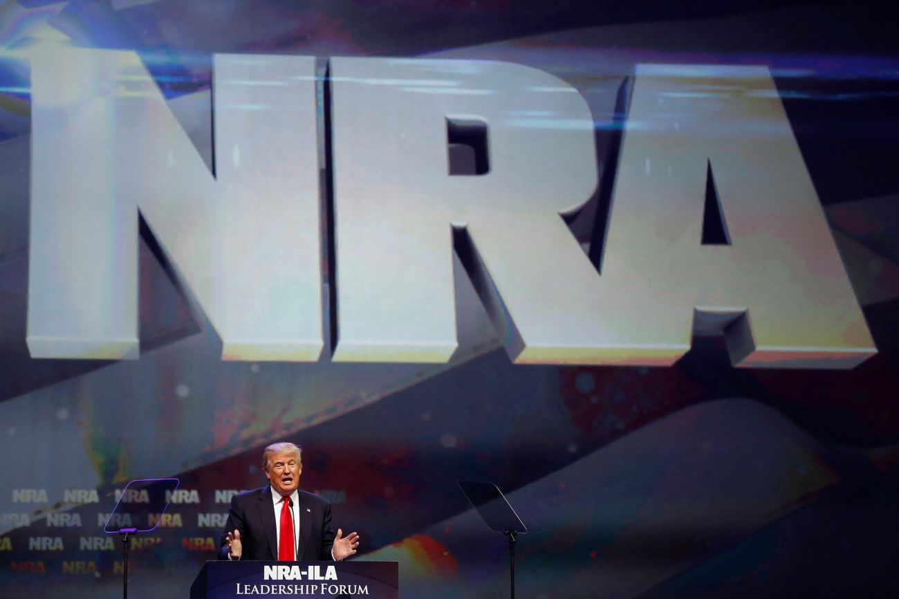 Republican presidential candidate Donald Trump attends the National Rifle Association's NRA-ILA Leadership Forum in Louisvill