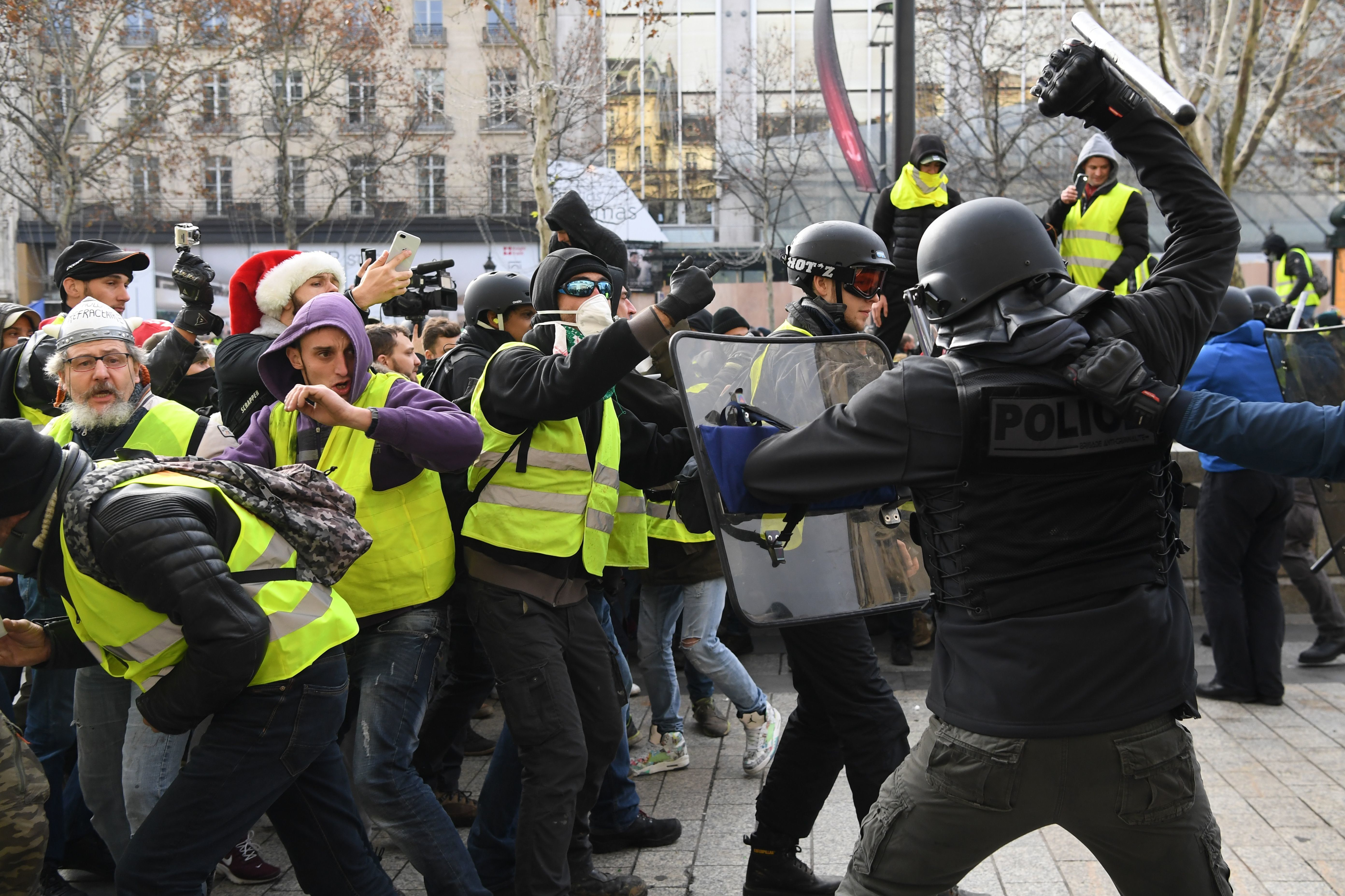Riot police clash with French protesters Saturday.