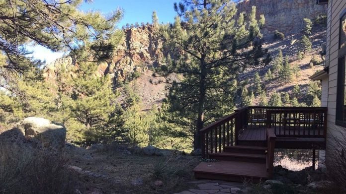 Chris Cook worked with a county program to create defensible space around his Boulder, Colorado, home, including cutting back