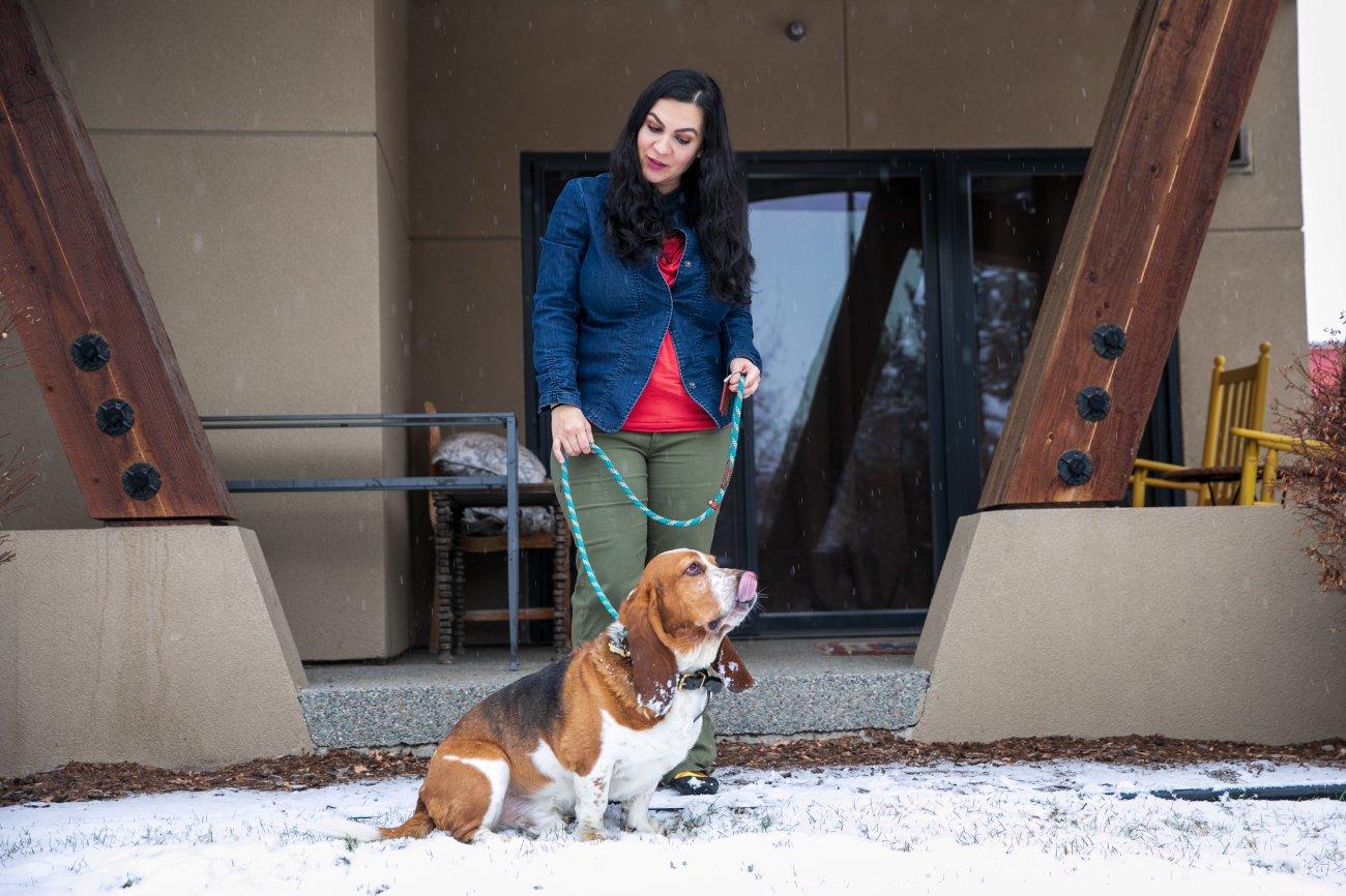 Nina Kouprianova takes her basset hound, Rody, out in Whitefish, Montana.