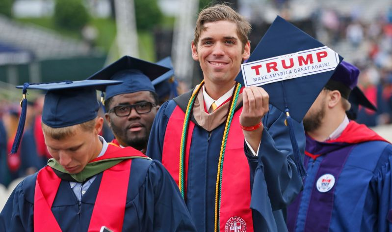 "Liberty University student David Westcott Jr. displays a ""Make America great again"" sticker on his mortarboard during the&nbs"