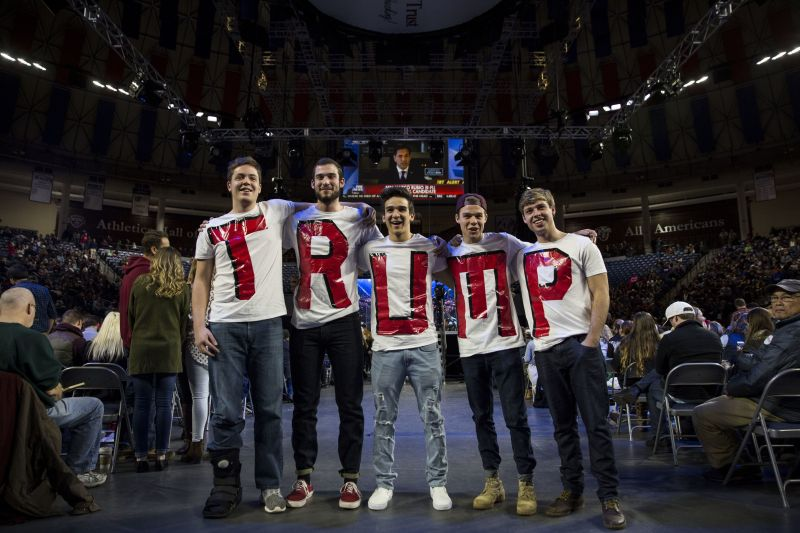 Liberty University students wear T-shirts spelling the president's name before his appearance at a school convocation, J
