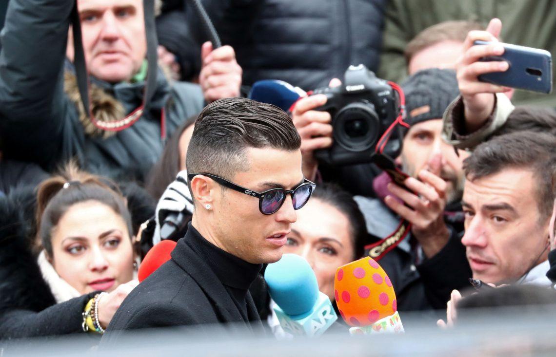 Cristiano Ronaldo leaves court in Madrid after accepting a deal in an ongoing tax fraud case.