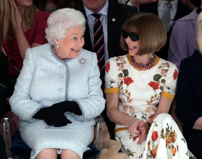 Queen Elizabeth sits next to Anna Wintour as they view Richard Quinn's runway show on Feb. 20, 2018.