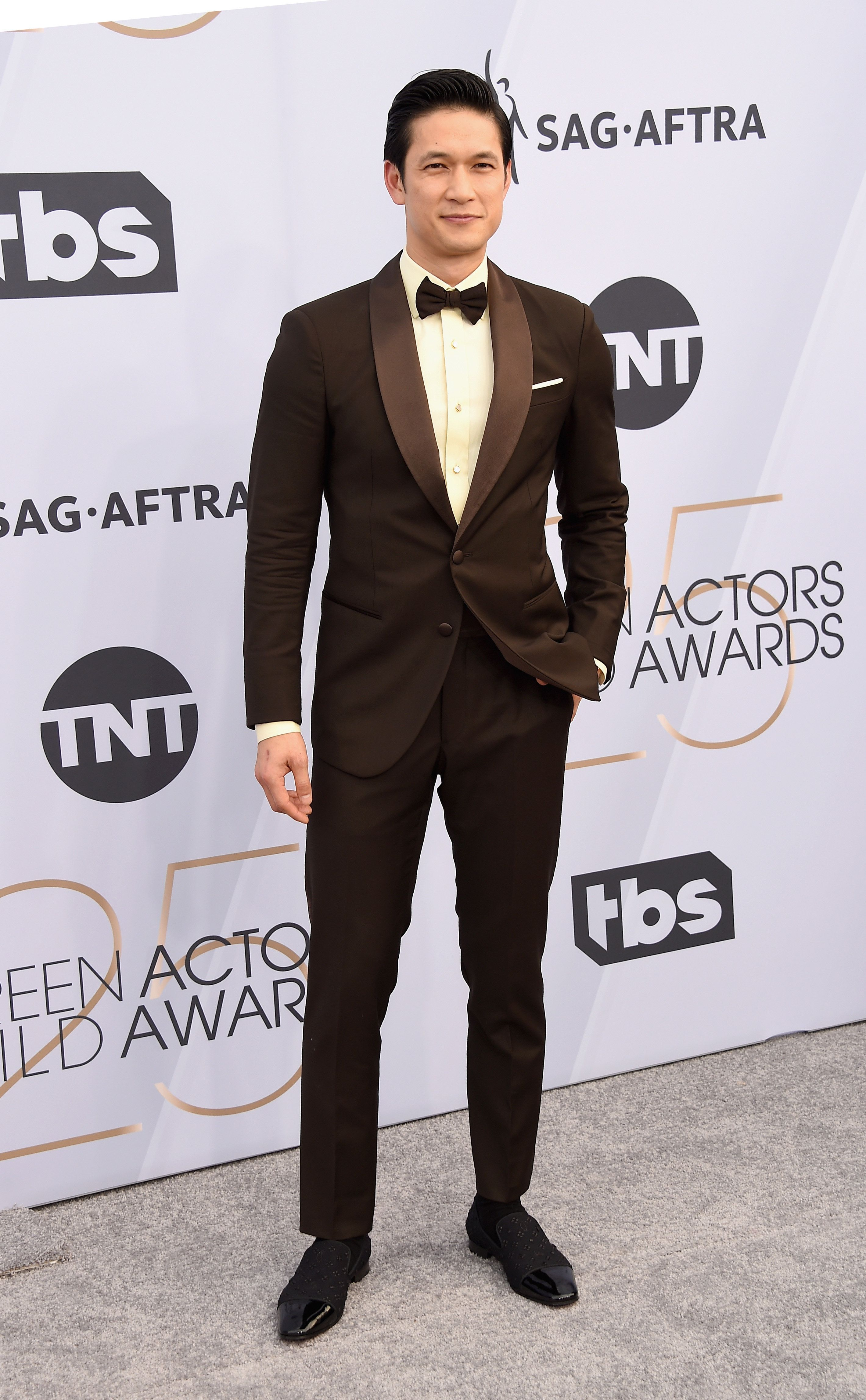 Harry Shum Jr. in a traditional black tux.