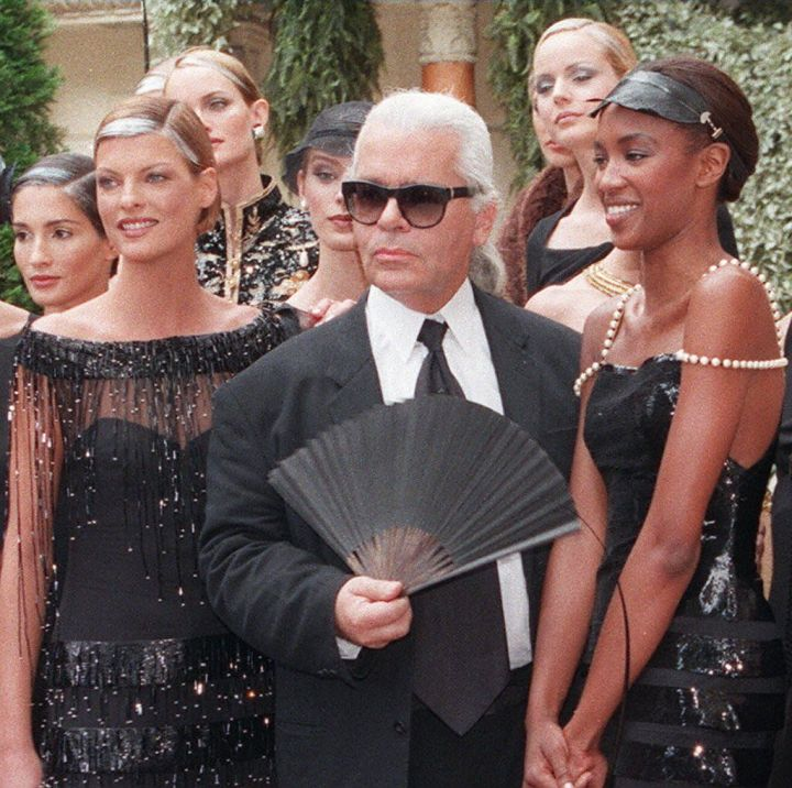 Karl Lagerfeld is surrounded by models during the closing of the Fall / Winter 1996-1997 fashion presentation in Paris.