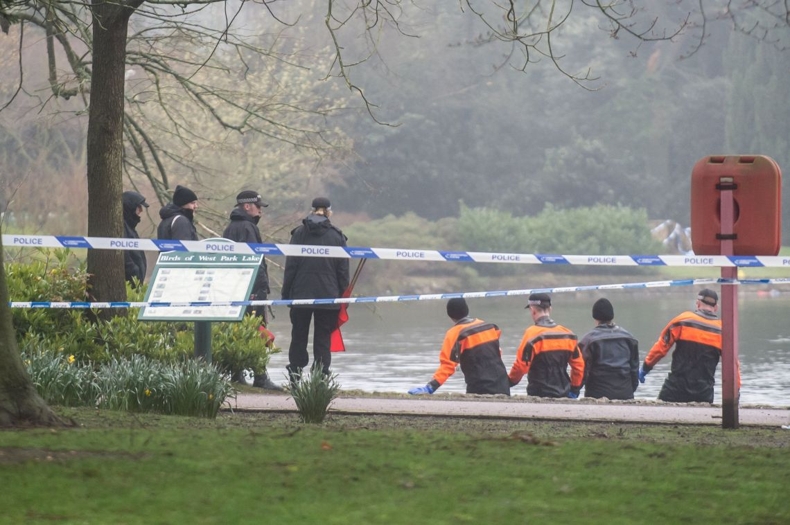 Officers combing the park's boating lake after the discovery of Viktorija's body