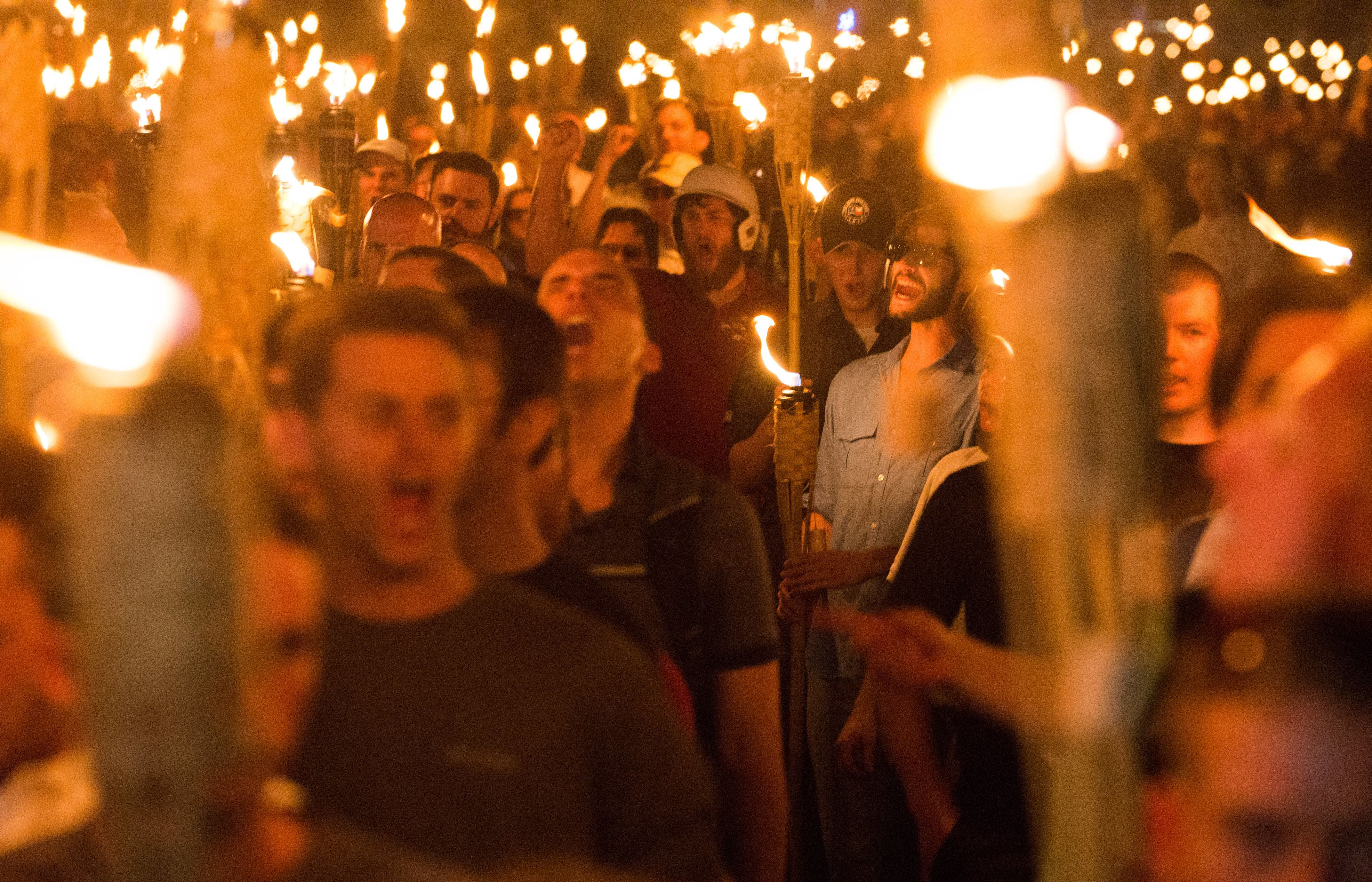 White nationalists and neo-Nazis marching on Aug. 11, 2017, the night before the Unite the Right rally inCharlottesvill