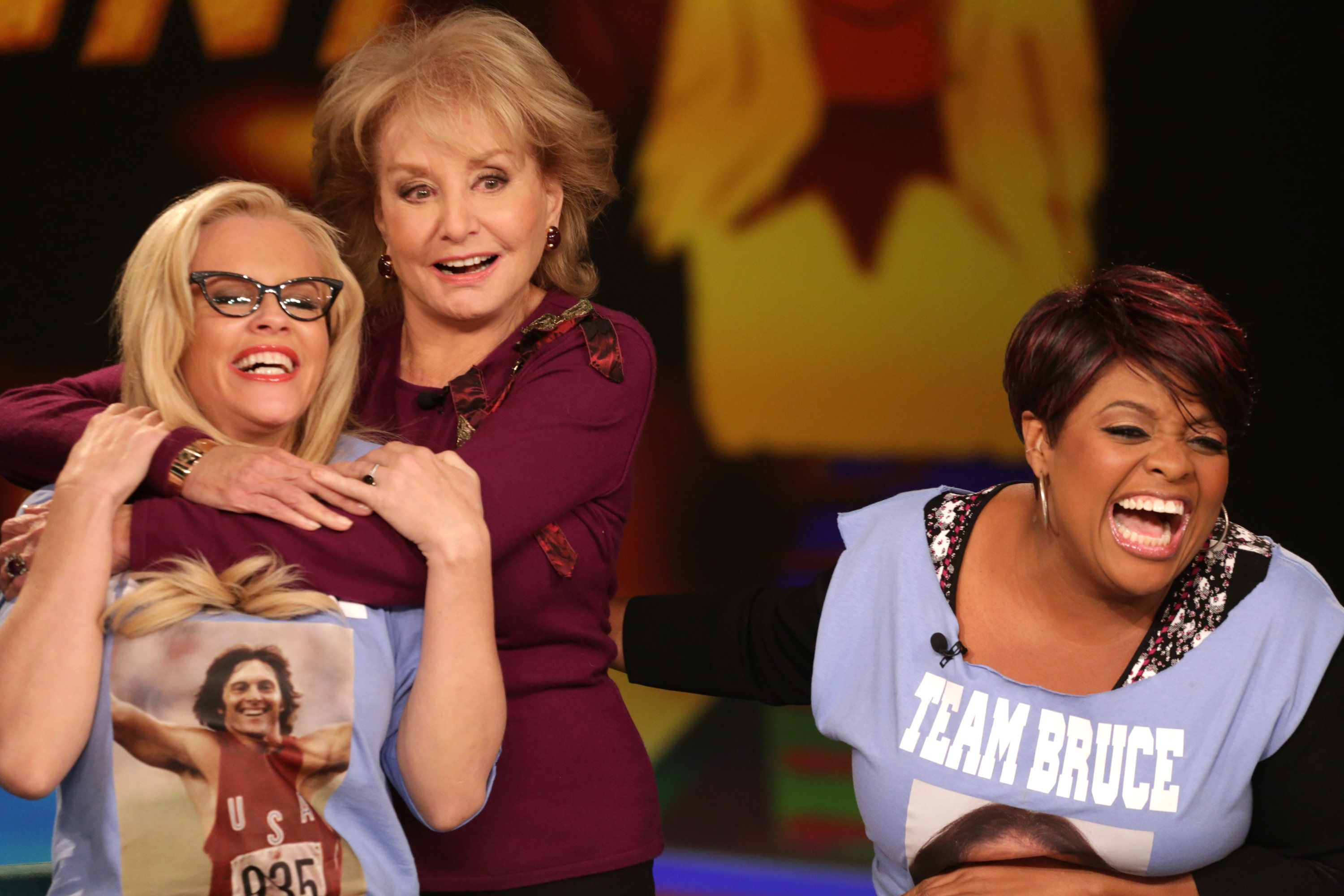 "Walters gives McCarthy a hug as co-host Sherri Shepherd laughs in a December 2013 episode of ""The View."""