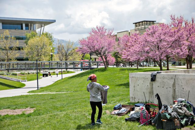 Dorriane Olson, 47, organizes her belongings in the courtyard at Library Square on May 1, 2019, in downtown Salt Lake City. O