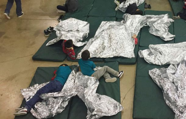 Children lie on floor mats at a facility in McAllen, Texas, on June 17, 2018. A year later, migrants stilldescribe slee