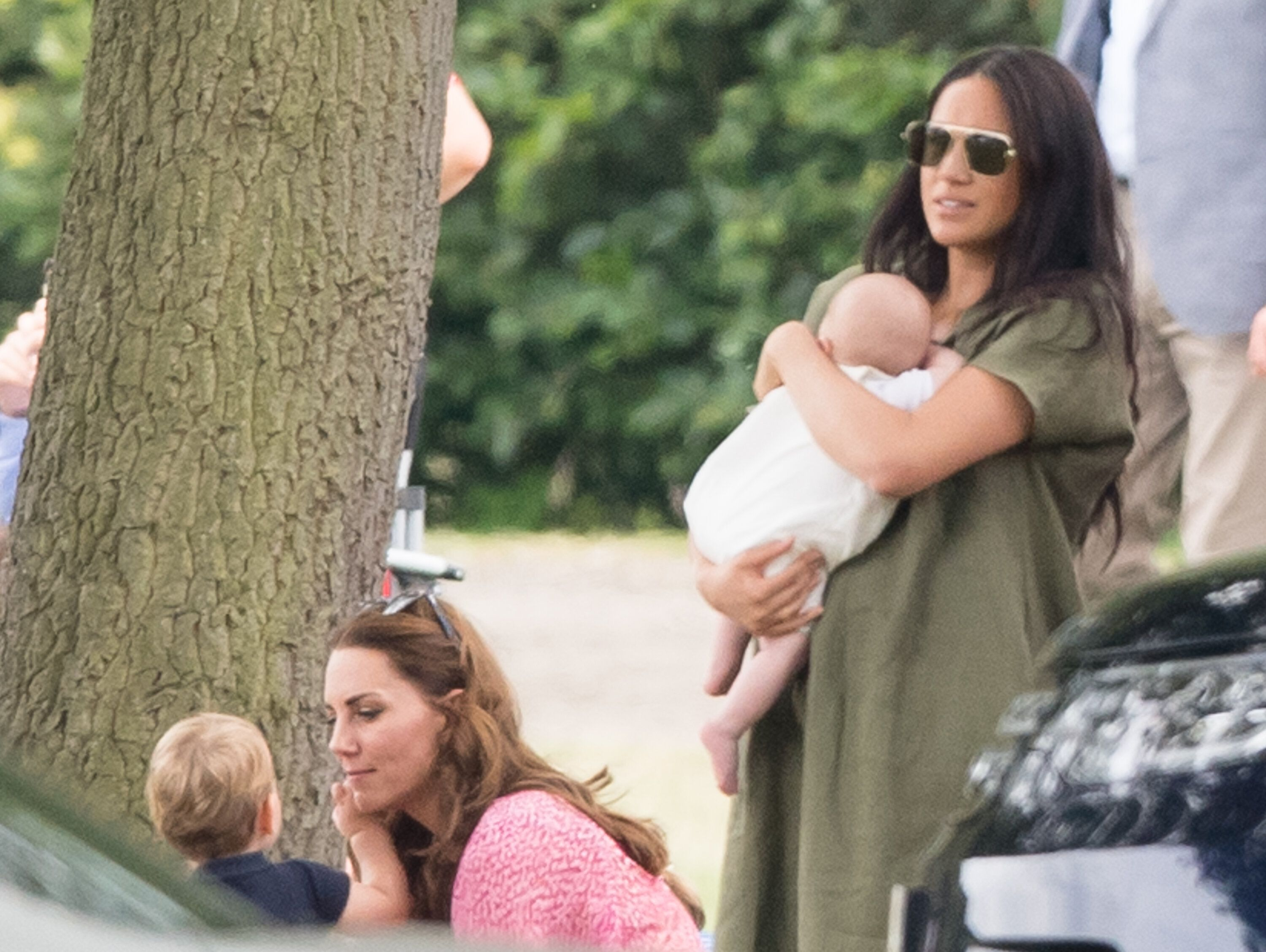 Kate and Meghan tending to their children.