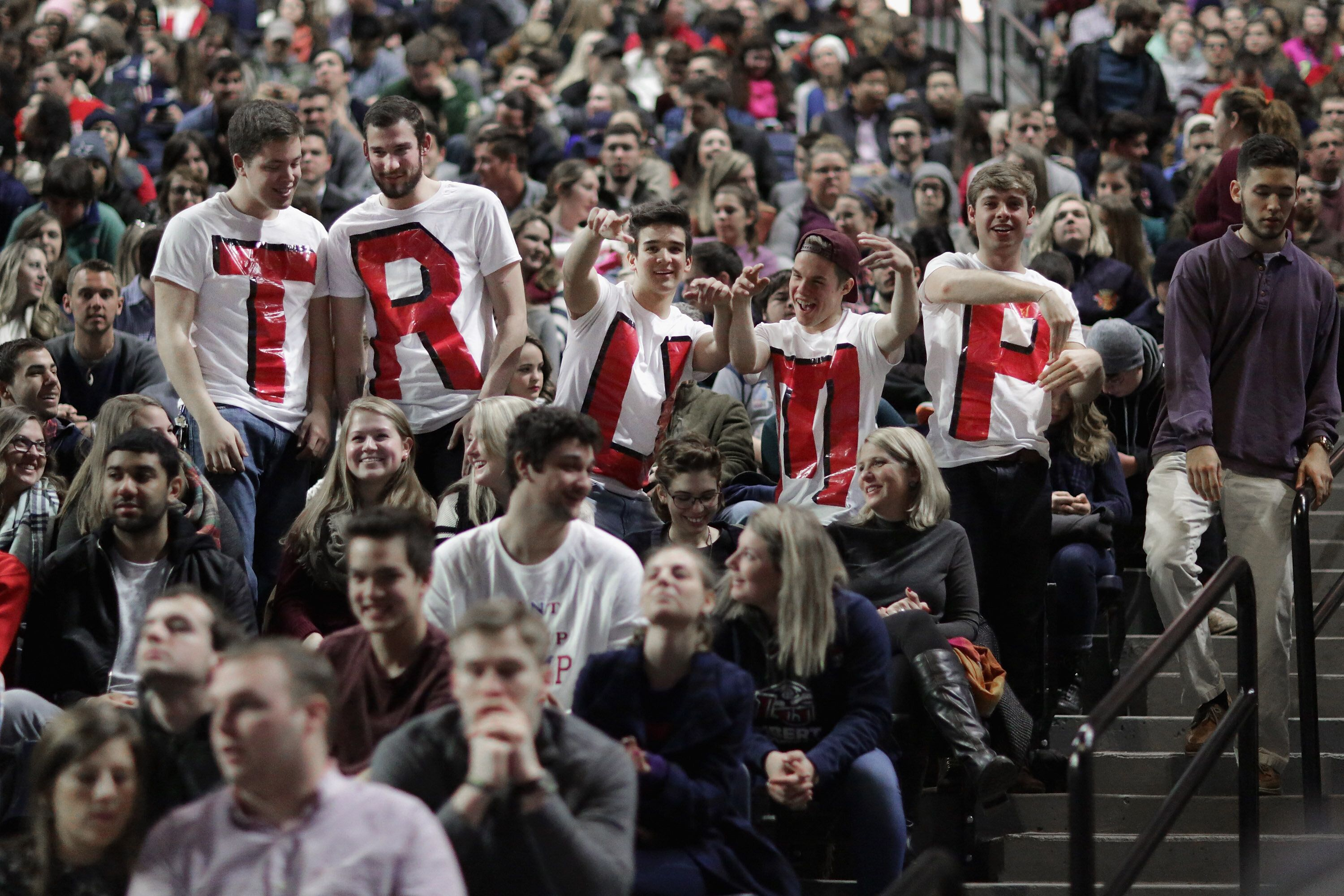 "Liberty University students wear homemade T-shirts spelling ""TRUMP"" while waiting for the arrival of then-candidate Donald Tr"