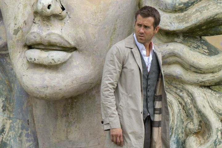 "Ryan Reynolds blending into a large statue in ""Self/less."""