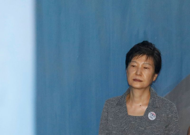 Former South Korean President Park Geun-hye arrives for her trial at the Seoul Central District Court in Seoul, South Korea, Friday, Aug. 25, 2017. Samsung heir Lee Jae-yong, the de facto leader of South Korea's most successful business group, was implicated in the massive political scandal that culminated into Park's ouster. (Kim Hong-Ji/Pool Photo via AP)