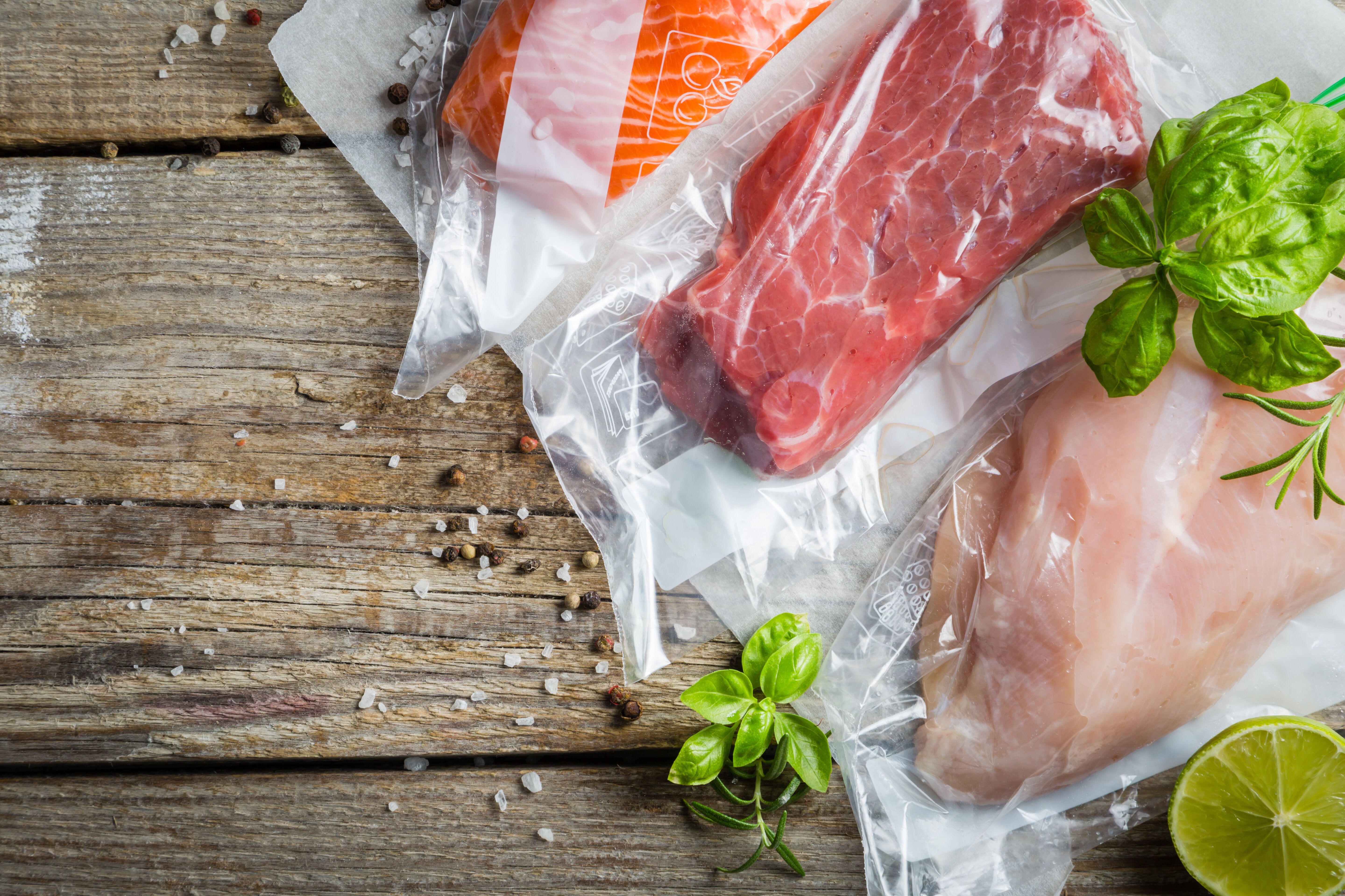 Beef, chicken and salmon in vacuum plastic bag for sous vide cooking, copy