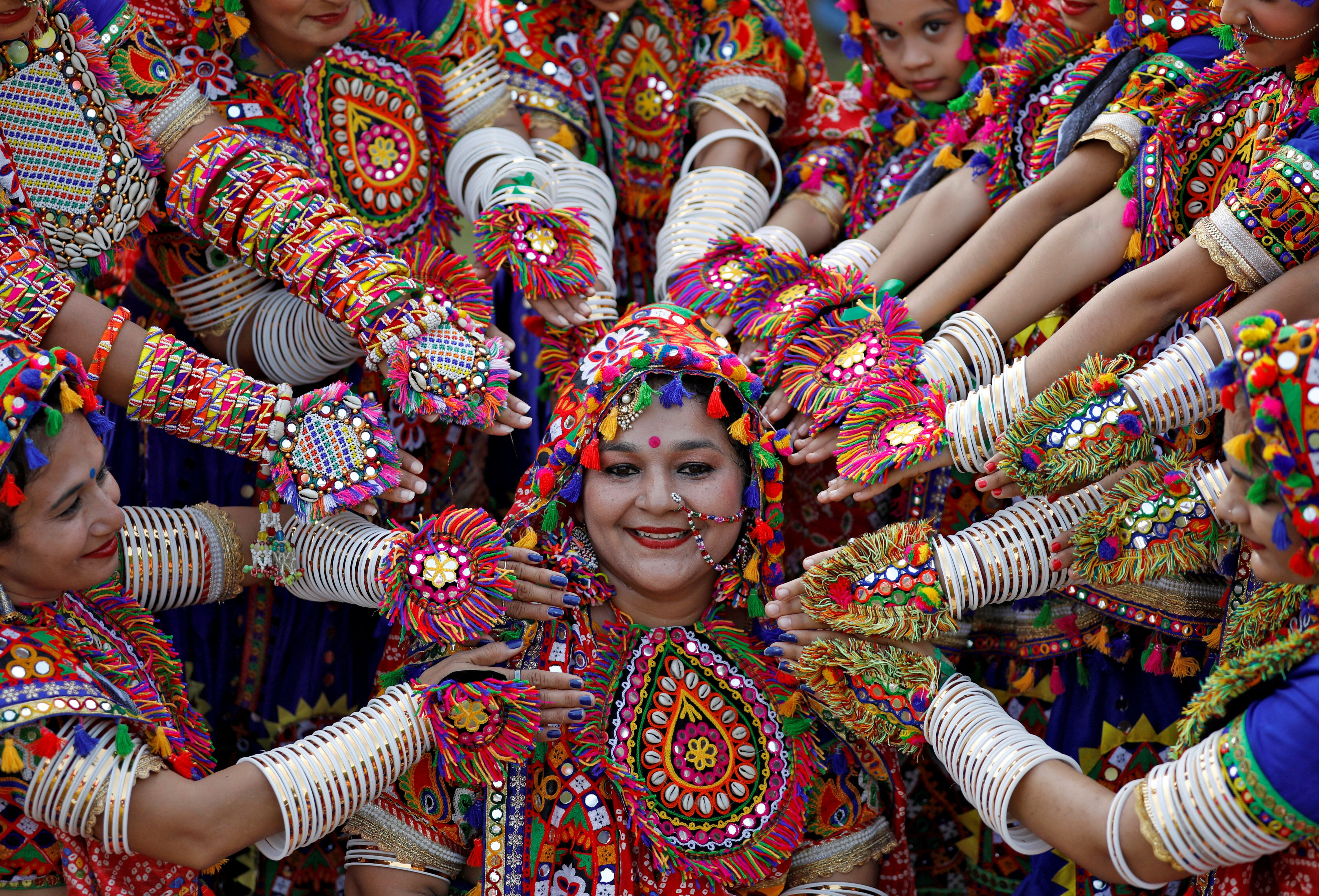 Participants dressed in traditional attire pose at rehearsals for Garba, a folk dance, in preparations for the Navratri, a fe