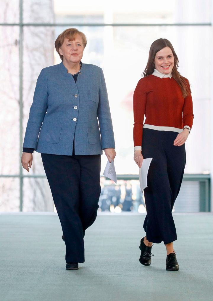 Iceland Prime Minister Katrin Jakobsdottir (right) prepares to talk to journalists with German Chancellor Angela Merkel on March 19, 2018, in Berlin.