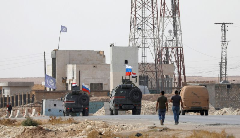 Russian and Syrian national flags flutter on military vehicles near Manbij, Syria October 15, 2019. REUTERS/Omar Sanadiki