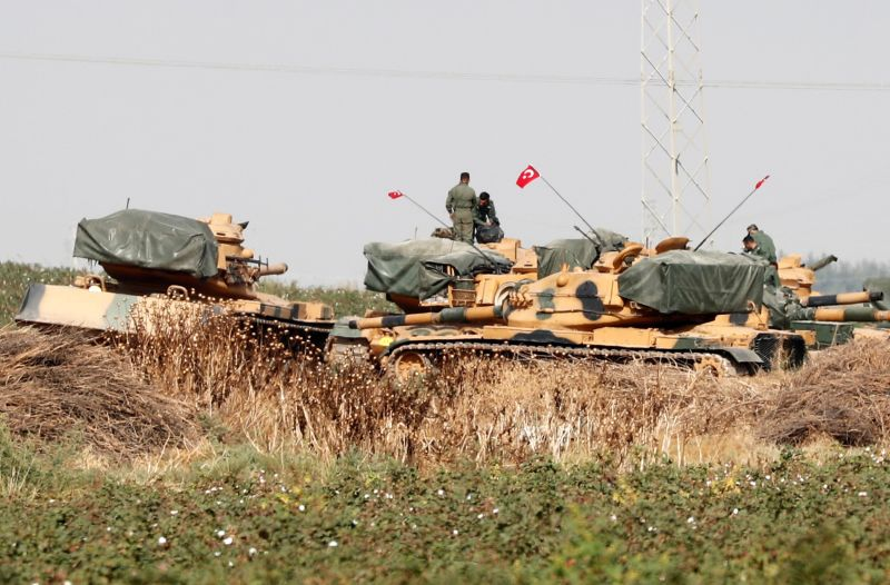 Turkish soldiers stand on top of tanks near the Turkish-Syrian border in Sanliurfa province, Turkey, October 15, 2019. REUTERS/Murad Sezer