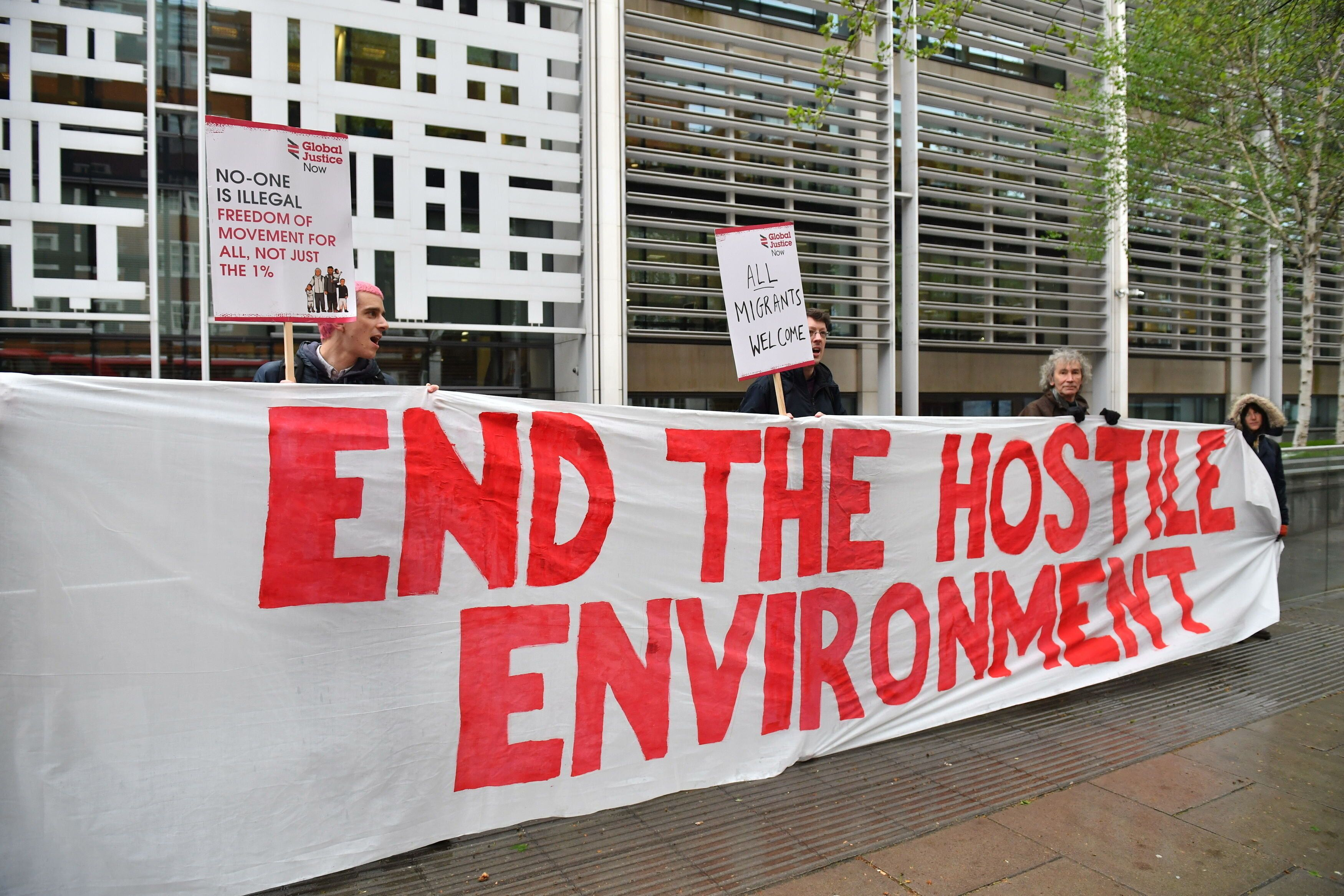 Demonstrators protest against the hostile environment immigration policy outside the Home Office in Westminster, London. Ambe
