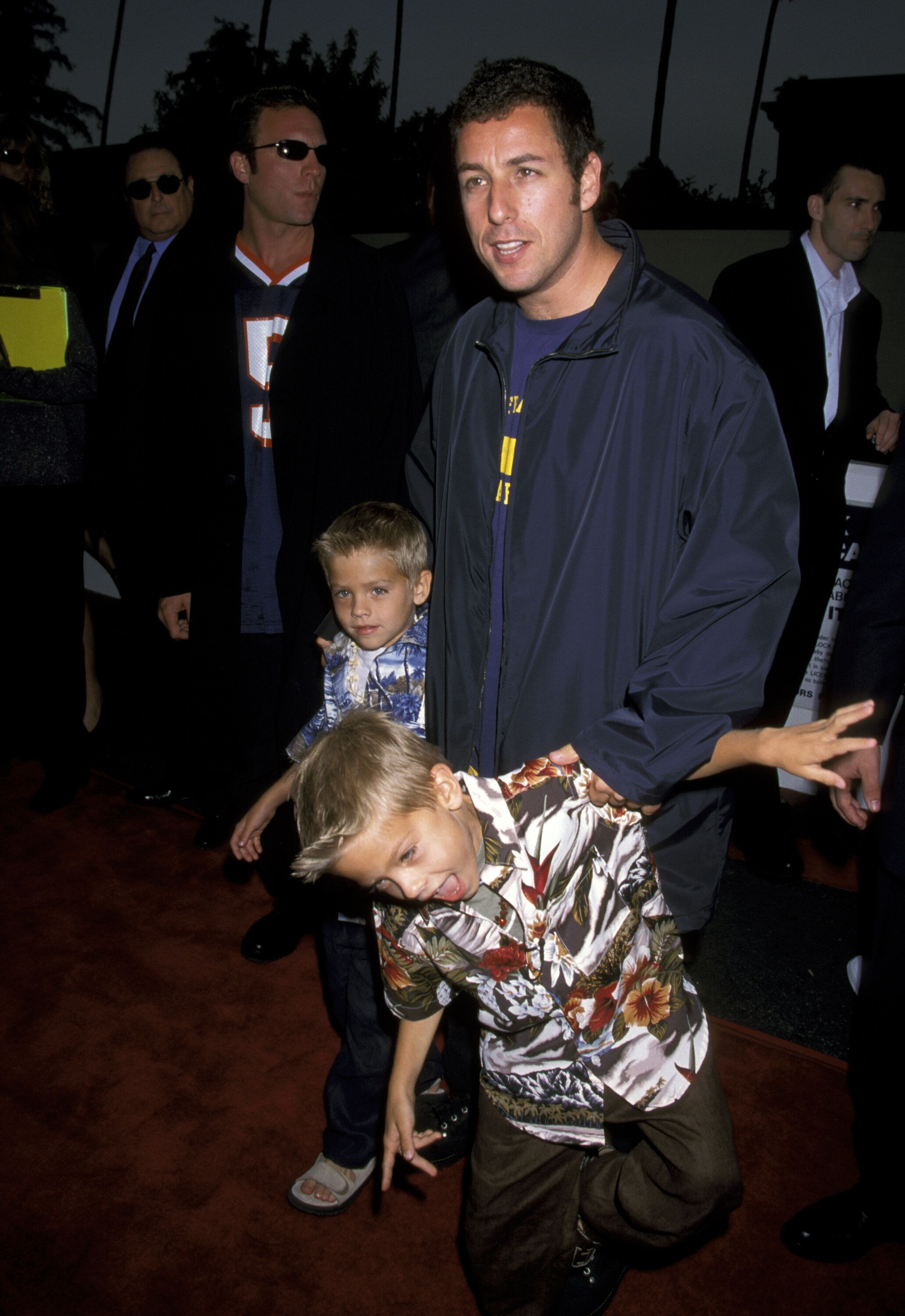 Adam Sandler, Cole Sprouse and Dylan Sprouse at the Avco Cinema in Westwood, California, in 1999.