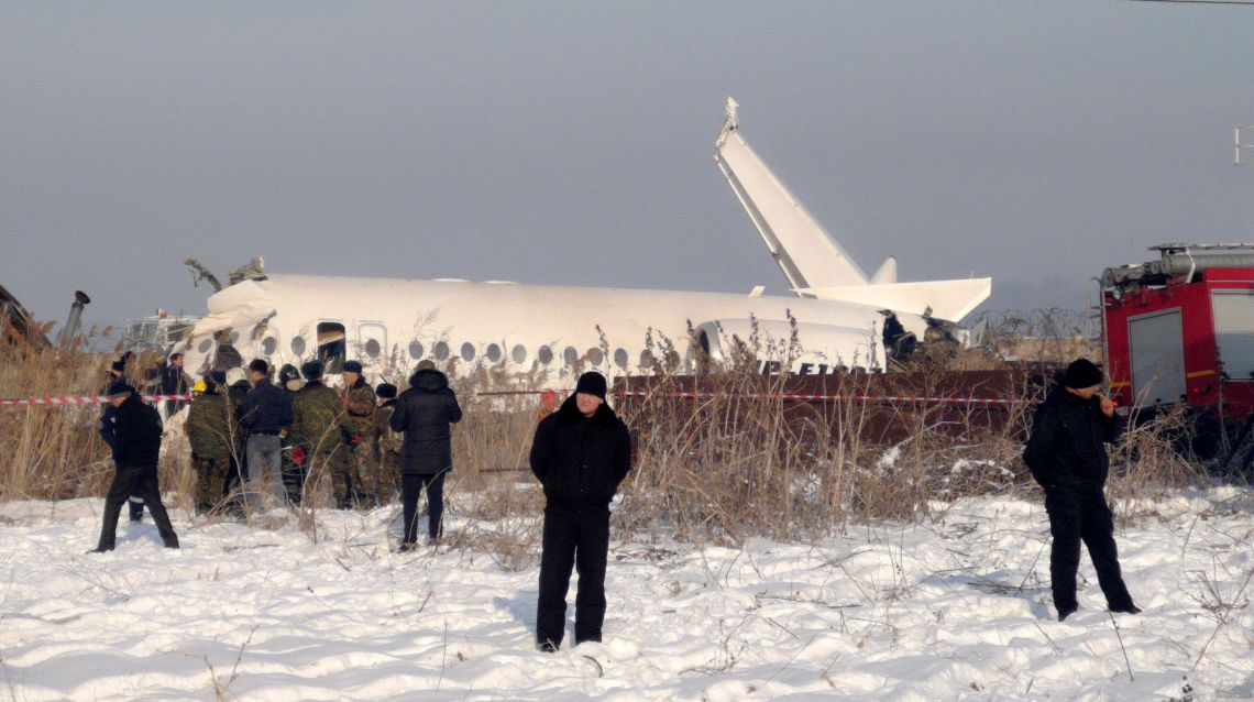Police stand guard as rescuers assist on the site of a plane crash near Almaty International Airport, outside Almaty, Kazakhstan, Friday, Dec. 27.