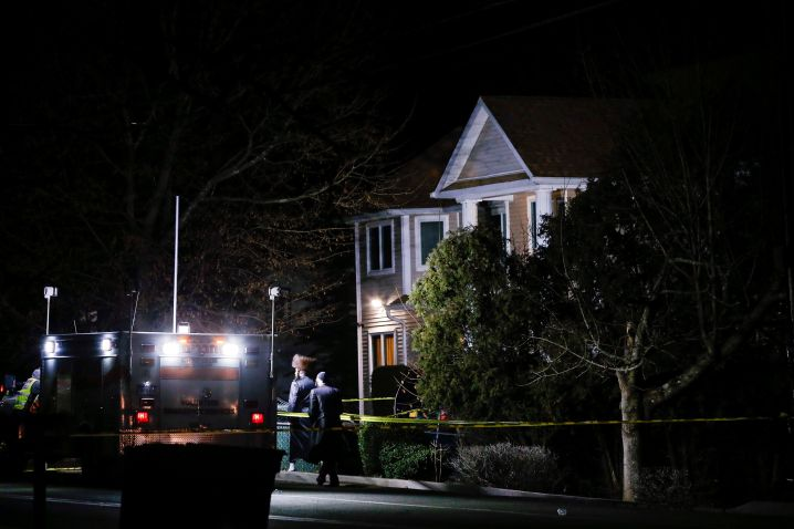 People walk in front of a house where 5 people were stabbed at a Hasidic rabbi's home in Monsey, New York, U.S., December 29.