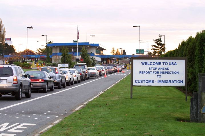 Vehicles line up to enter the United States at a border crossing between Blaine, Washington and White Rock, British Columbia