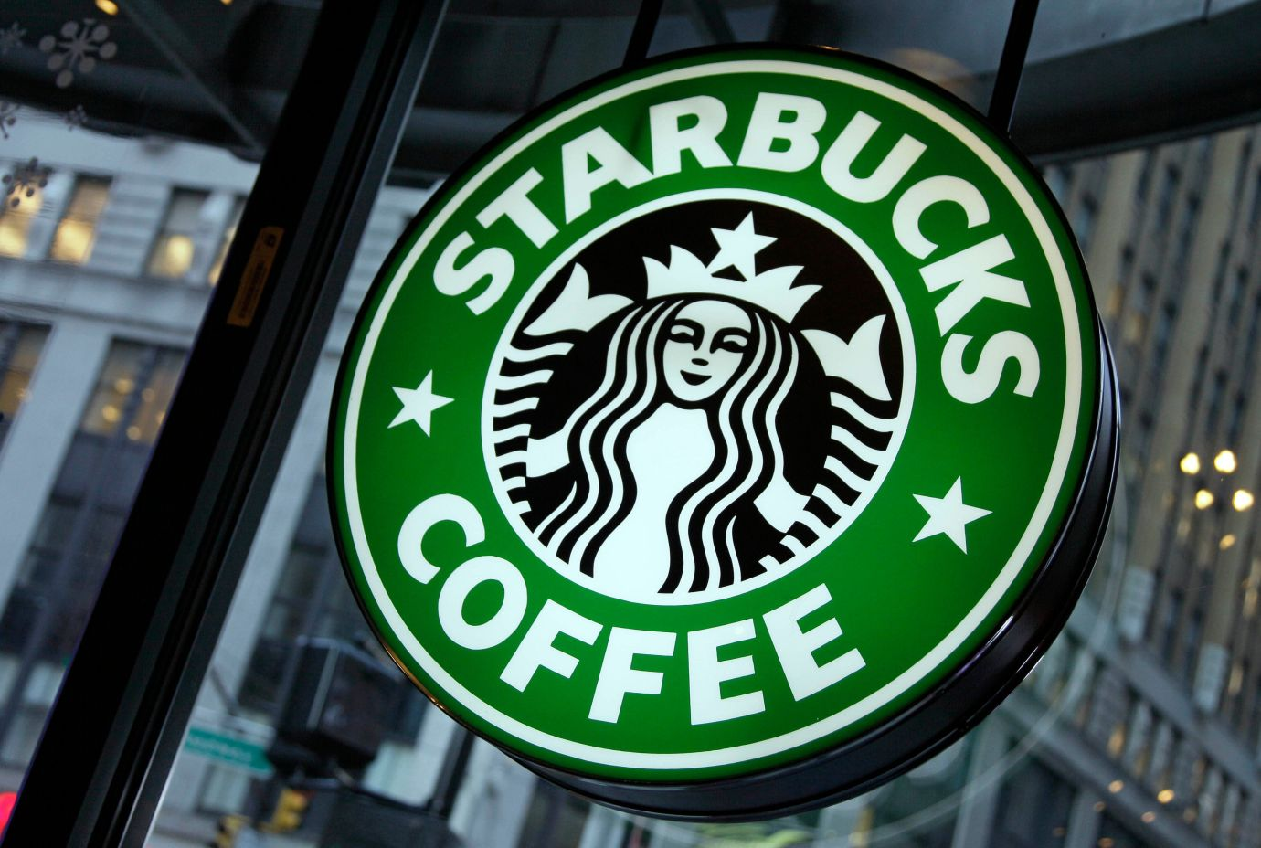 In this 2010 file photo, a Starbucks sign is seen in New York City. The company says customers in Canada will soon be able to down fake meat with their Frappuccinos.