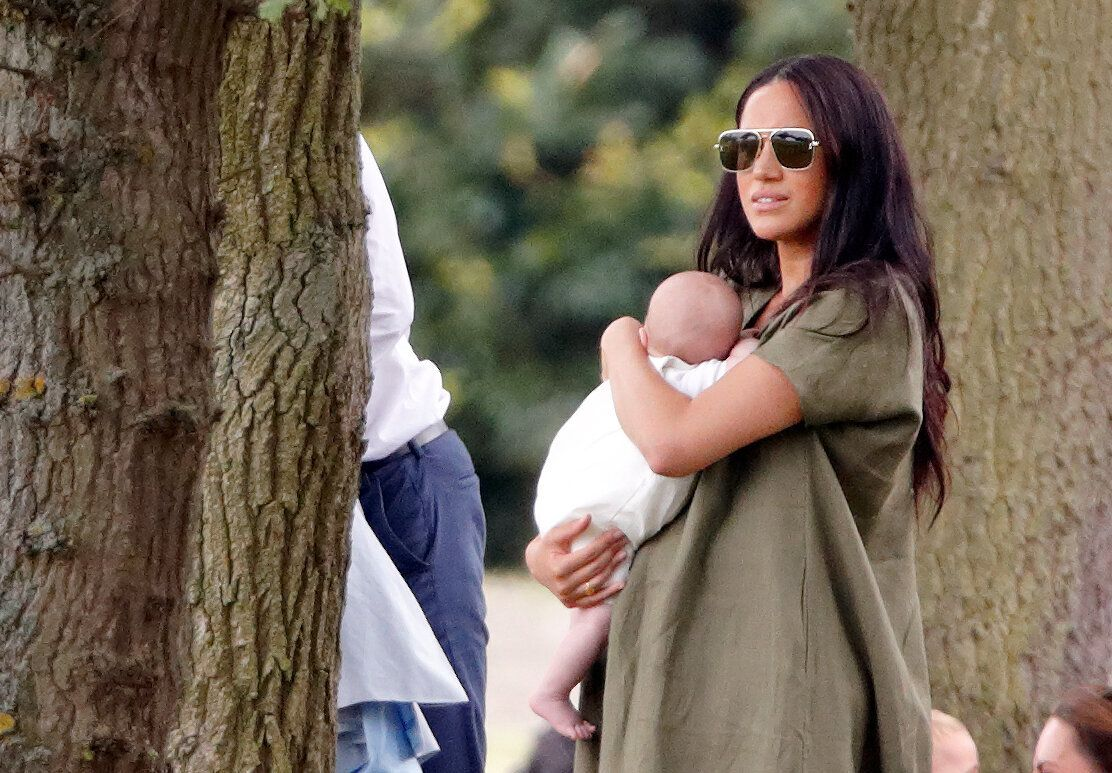 Meghan holds Archie at thethe King Power Royal Charity Polo Match.