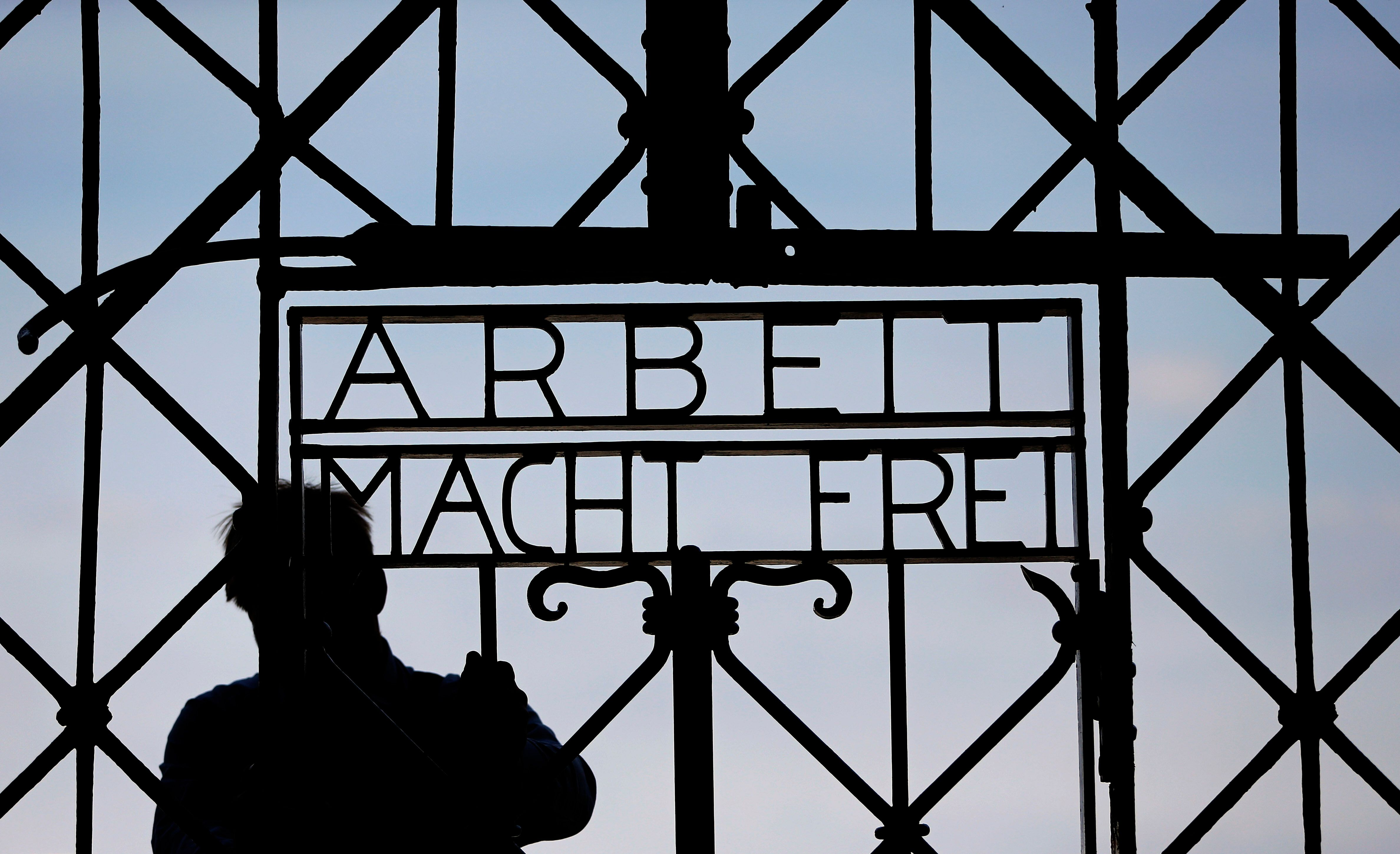 Auschwitz Museum Condemns Use Of Nazi Slogan At Illinois COVID-19 Protest 1