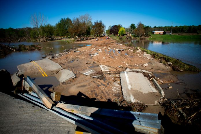 Ruins of the Curtis Road Bridge lie asunder as waters continue to roil on May 20, 2020, in Edenville Township north of Midlan