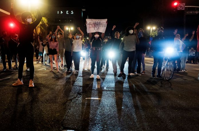 Demonstrators block traffic during a protest Wednesday in Los Angeles over the death of George Floyd in Minneapolis.