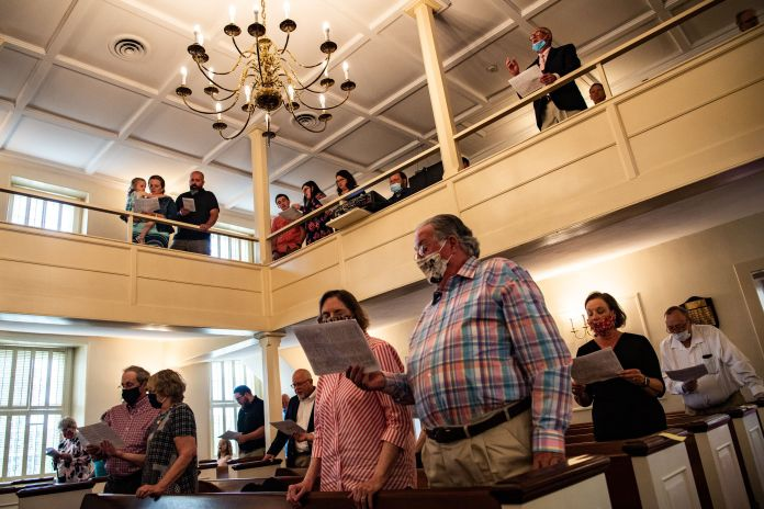 Worshipers participate in a service at Hopeful Baptist Church on Sunday, May 17, in Montpelier, Virginia.