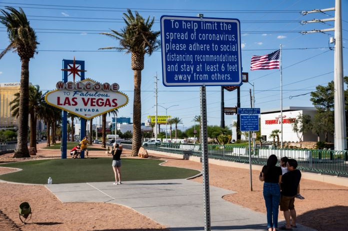 Signs now posted in many parts of Las Vegas stress the recommended social distancing to help stem the coronavirus pandemic.