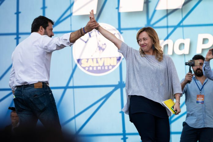 Matteo Salvini introduces onstage the leader of Fratelli d'Italia Giorgia Meloni during a rally organized ...