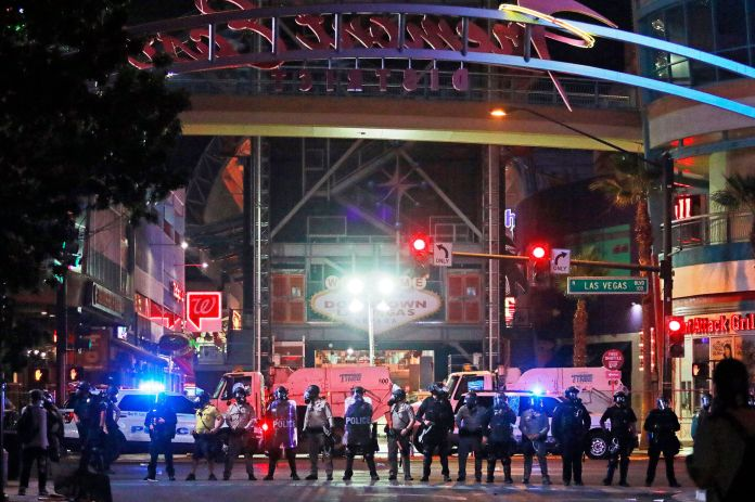 Police stand in formation at the entrance to Fremont Street Experience on June 1, 2020, in downtown Las Vegas.