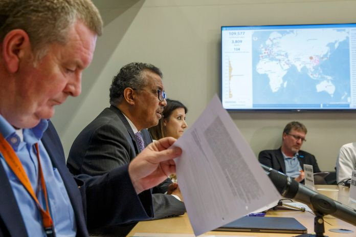 In this Monday, March 9, 2020 file photo, Tedros Adhanom Ghebreyesus, second left, director-general of the World Health Organ