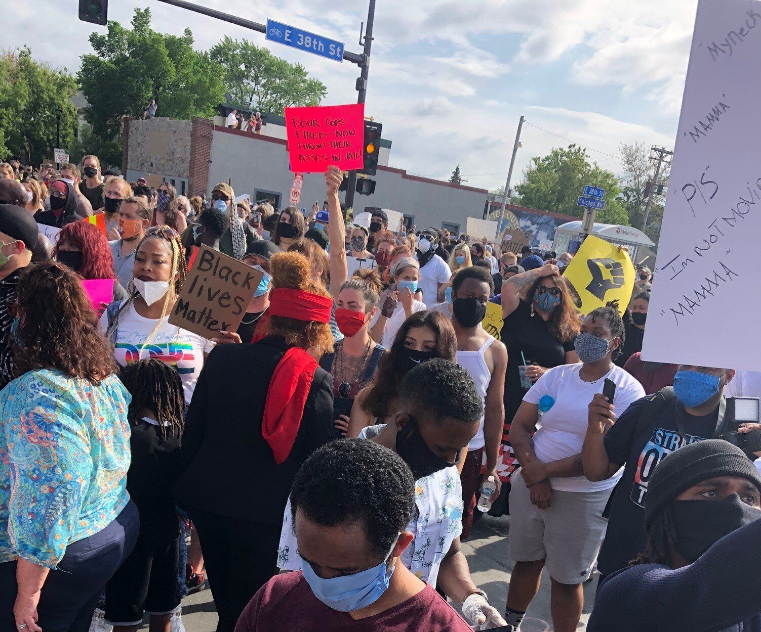 Protesters on the corner of 38th Street and Chicago Avenue in Minneapolis, where Floyd died.