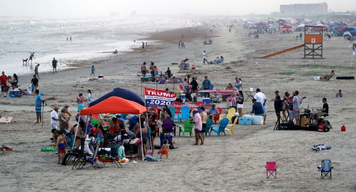 The beach in Port Aransas, Texas, on May 23 shows tight groupings even though beachgoers had been urged to practice social di