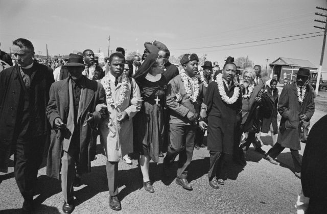 John Lewis seen third to the left with Dr Martin Luther King Jr. as they begin the Selma to Montgomery civil rights march fro