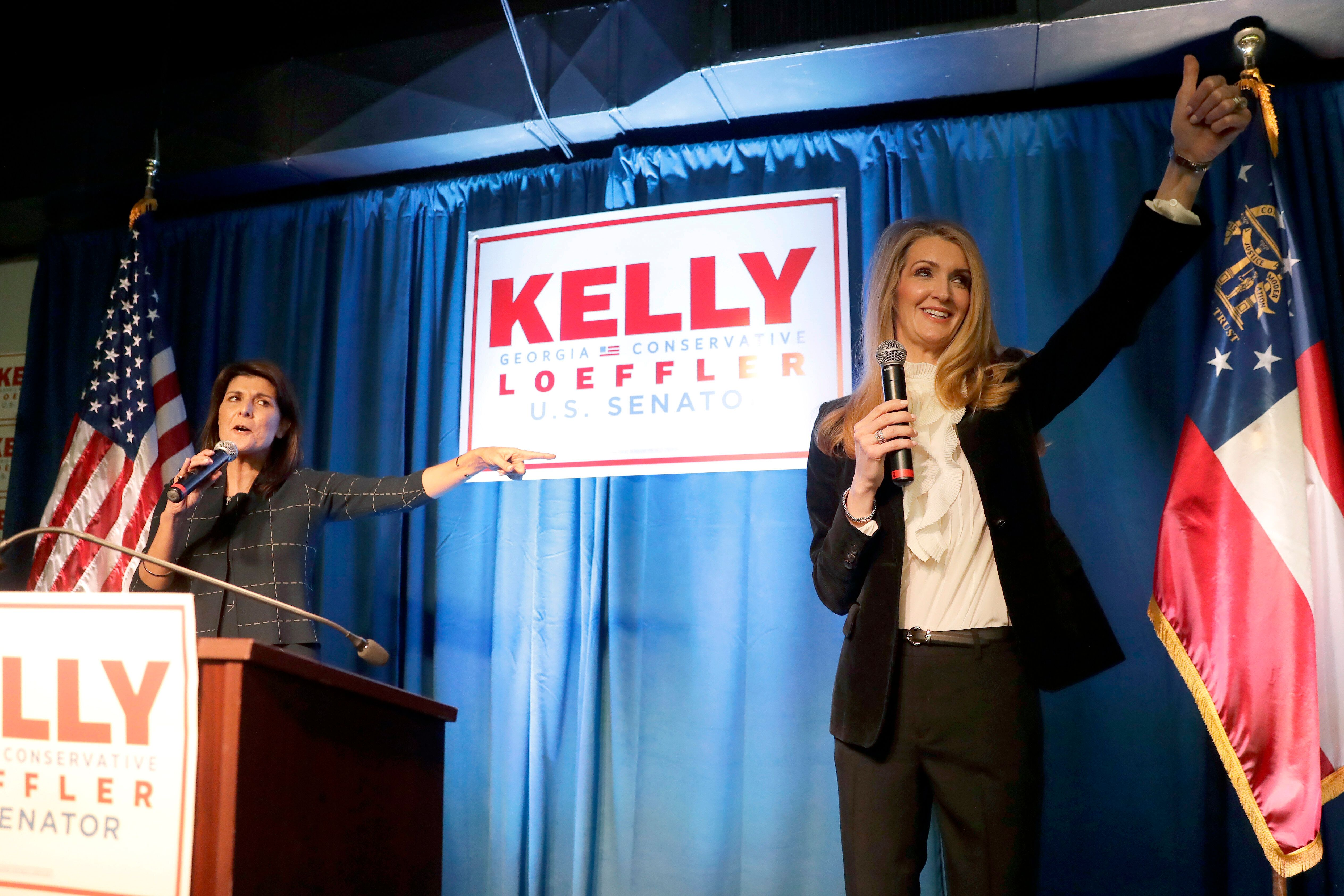 Sen. Kelly Loeffler, seen here at a campaign rally in March with former U.N. Ambassador Nikki Haley, warns that supporting th
