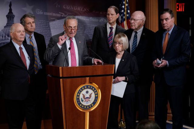 Senate Minority Leader Chuck Schumer (D-N.Y.) and fellow Democrats hold a news conference March 11 to discuss emergency paid
