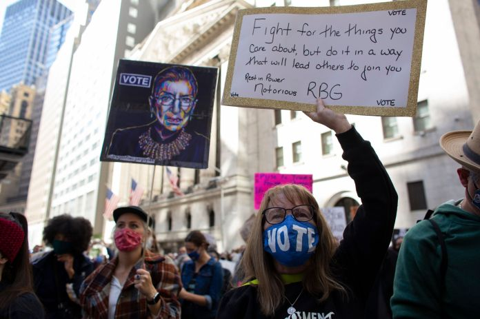 The late Justice Ruth Bader Ginsburg, whose seat Barrett has been nominated to fill, appeared on many signs on Saturday.
