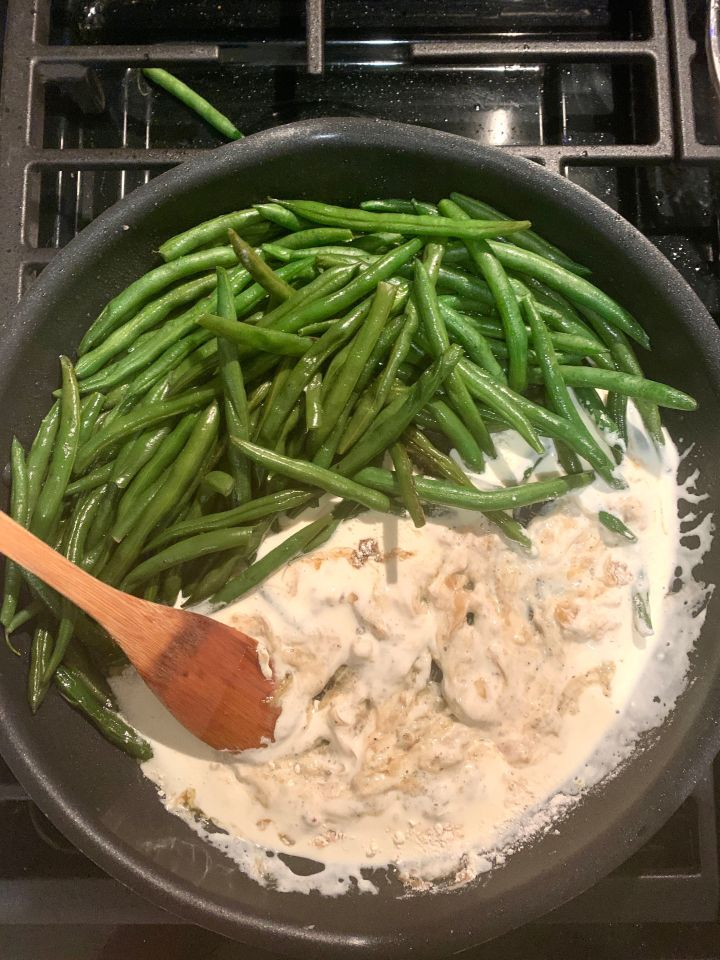 The author whipping up Home Chef's Thanksgiving side recipe forcaramelized onion green bean casserole. As an added bonus, most recipes could be made with one or two pots and pans.