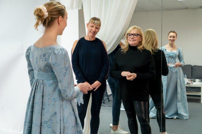 Costume designer Ellen Mirojnik working to fit one of the 7,500